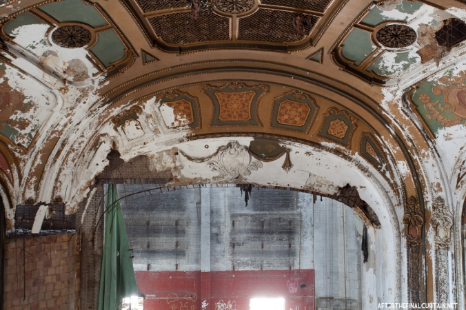 The proscenium arch has become water damaged in the years since the theater closed.