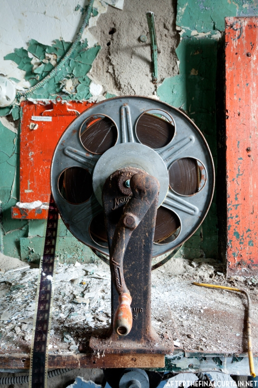 The hand cranked film rewinder still has one of the last movies to be shown at the theater in it.