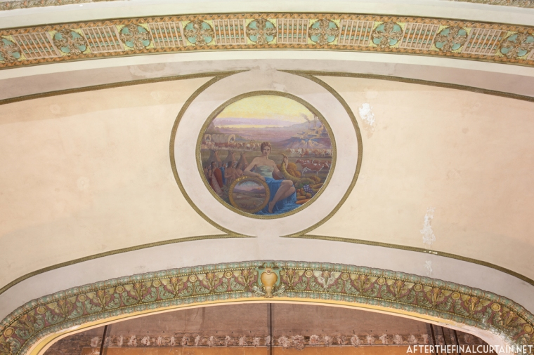 The mural on the proscenium arch was painted by William Peaco.
