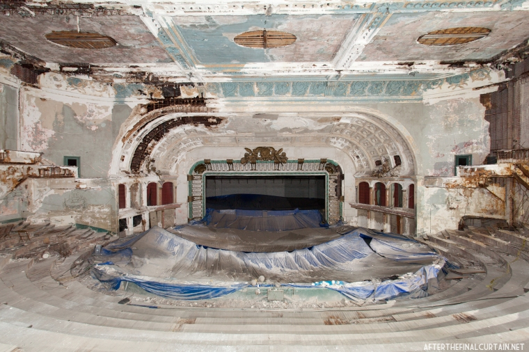 The blue tarp was placed there to protect the church floor from falling plaster.