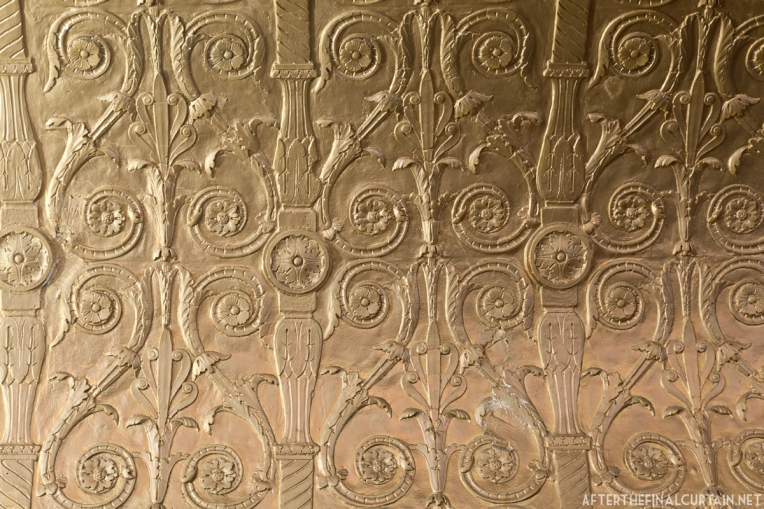 A close up of some of the plaster-work on the side of the proscenium.