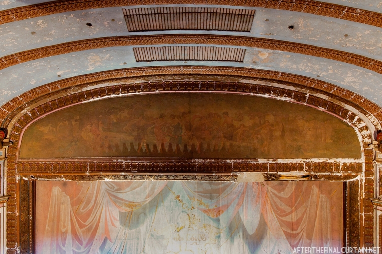 """The mural above the proscenium is entitled, """"The Allegory of the Muses,"""" and was painted by Harry Hawkins, a local artist."""