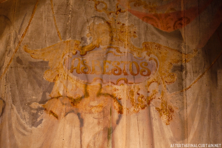 The original asbestos fire curtain still hangs in the auditorium.