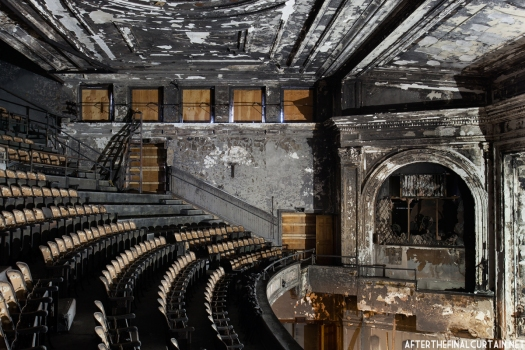 Most of the white paint in the auditorium has turned a greyish black due to the fire damage.