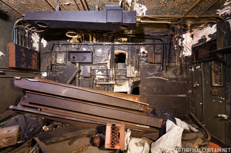 The interior of the projector room is full of construction debris.