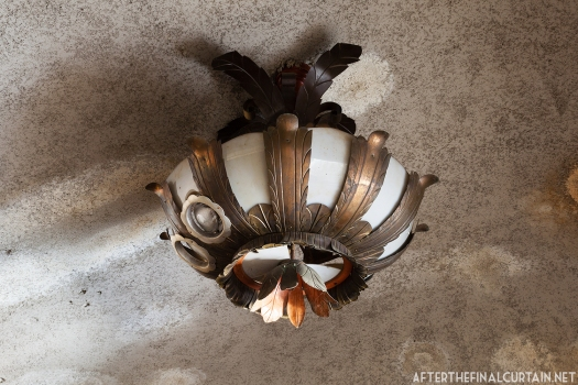A close up of one of the original light fixtures in the lobby.
