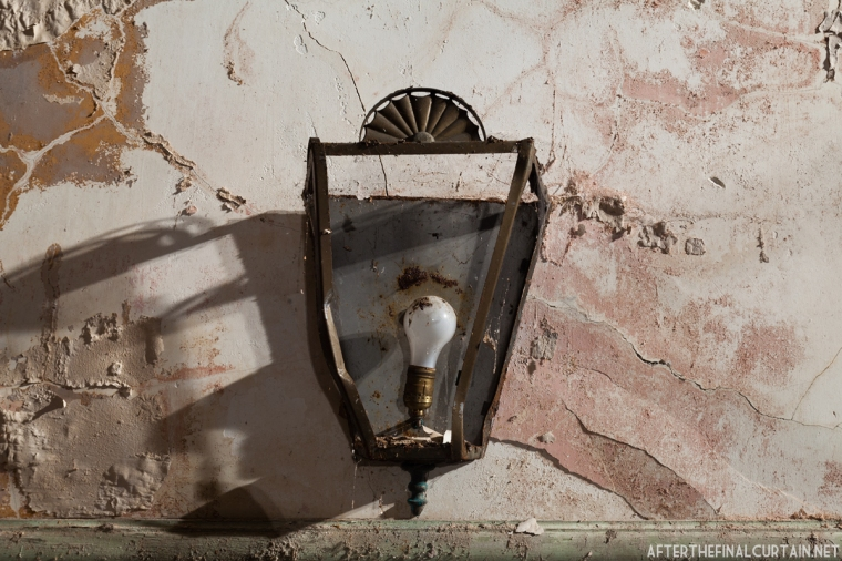 One of the surviving auditorium light fixtures.