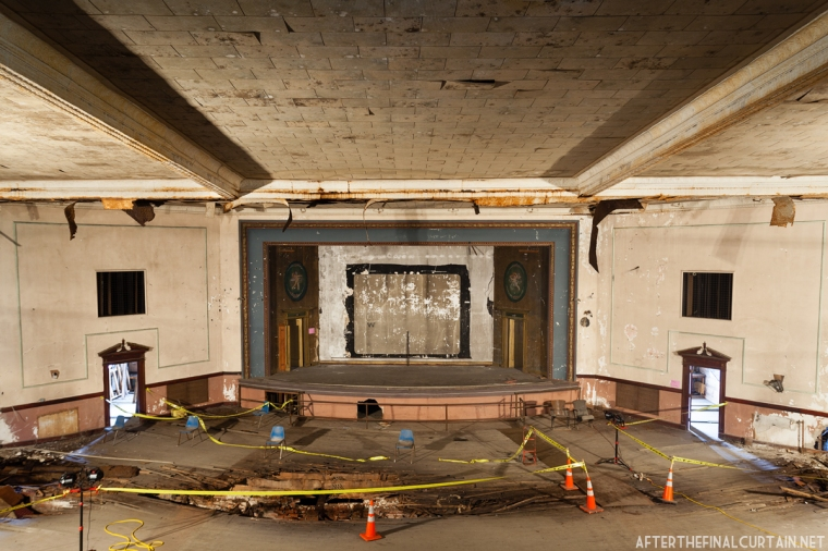 While the theater was closed water leaked in from the roof and caused the wooden auditorium floor to rot.