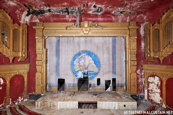 The fire curtain and proscenium arch of the California Theatre in San Diego, CA